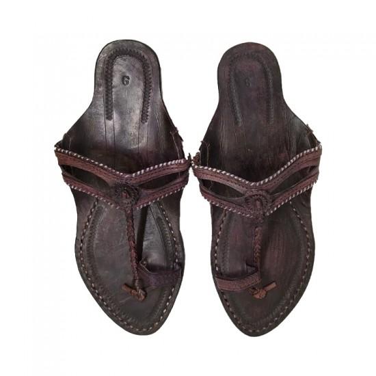 Buy black colored leather kolhapuri chappal for women.